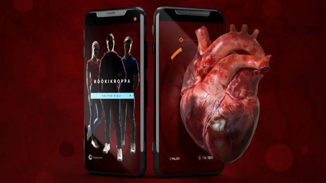 Röökikroppa.fi-sivustoa maiostavassa kuvassa on puhelimen ruutu, jossa näkyy osa sivuston käyttöliittymästä sekä sen viressä sydän.